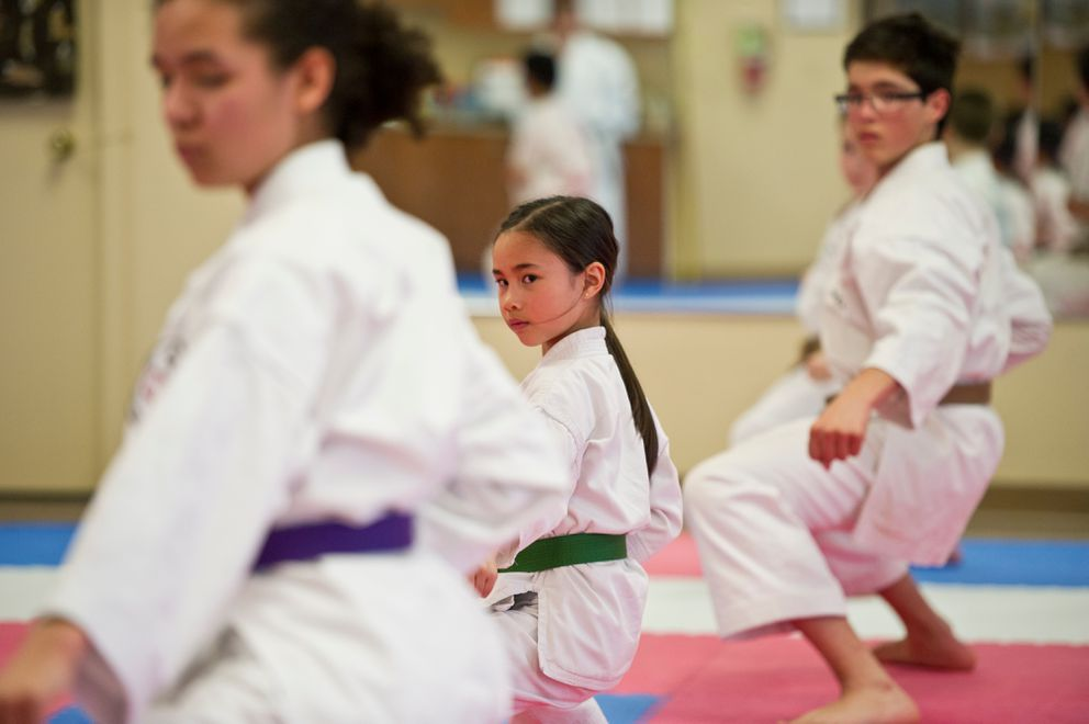 Victoria Tostemar, 8, center, practices karate in Tanaka's class on Wednesday, April 27, 2016. (Marc Lester / Alaska Dispatch News)