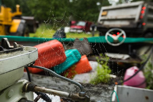 A rain-covered spiderweb on an old boat in South Anchorage Wednesday, Aug. 1, 2018. (Loren Holmes / ADN)