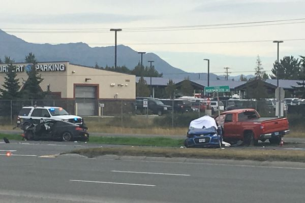 A multi-car crash Thursday afternoon, Aug. 15, 2019, at West International Airport Road and Northwood Drive left one woman dead and injured at least one other person, according to Anchorage police. Photographed from the north side of West International Airport Road. (Madeline McGee / ADN)