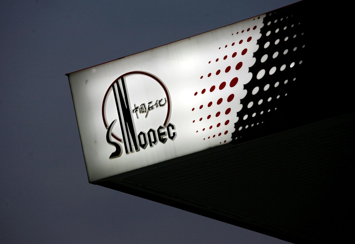 The Sinopec logo is seen at one of its gas stations in Hong Kong. (REUTERS/Bobby Yip/2010 file photo)