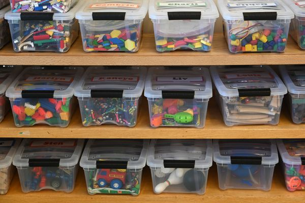 Tubs containing toys have names of students on them in a kindergarten classroom at Huffman Elementary on Monday, Nov. 2, 2020. (Bill Roth / ADN)