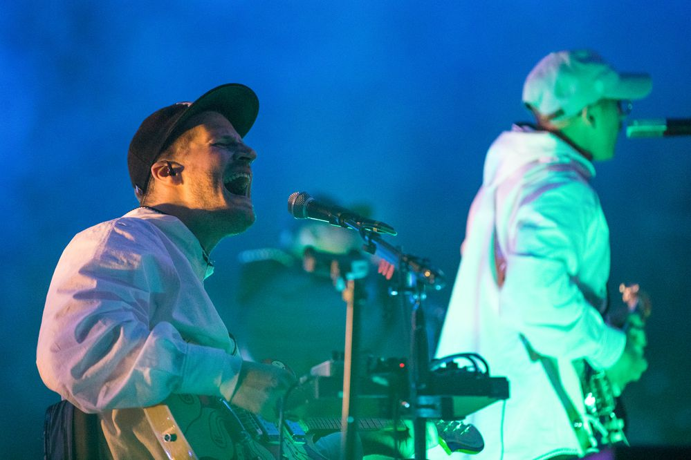 Guitarist Eric Howk performs with Portugal. The Man Friday, Oct. 26, 2018 at the Alaska Airlines Center. (Loren Holmes / ADN)