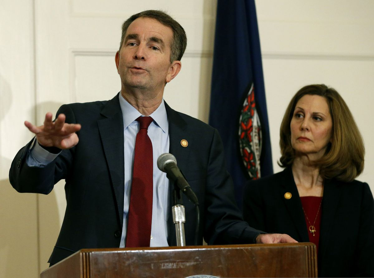 Virginia Gov. Ralph Northam, left, gestures as his wife, Pam, listens during a February 2019 news conference in the Governors Mansion at the Capitol in Richmond, Va. (AP Photo/Steve Helber, File)