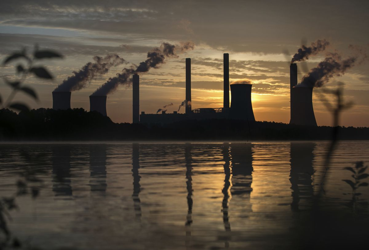 FILE - In this Saturday, June, 3, 2017 file photo, the coal-fired Plant Scherer, one of the nation's top carbon dioxide emitters, stands in the distance in Juliette, Ga.. (AP Photo/Branden Camp, file)