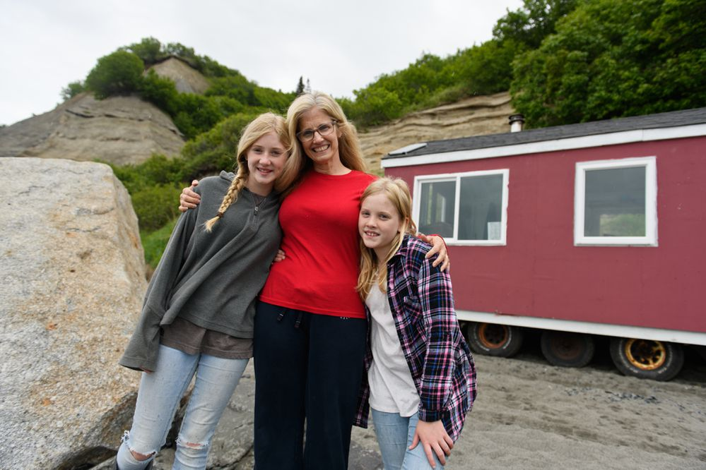 Rita Clucas and her daughters set up their family's set net fishing camp on the beach at Clam Gulch on June 21, 2018. Samara, 13, is at left and Avielle, 11, is at right. (Marc Lester / ADN)