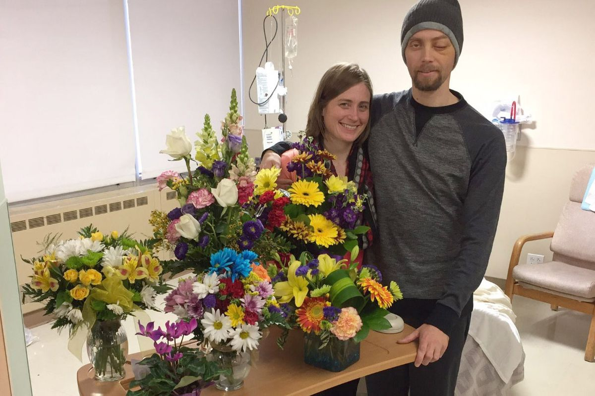 Natasha and Allen Brandt pose for a portrait before Allen's release from an Anchorage hospital. Allen was shot while on duty with the Fairbanks Police Department. (Courtesy of Brandt family)