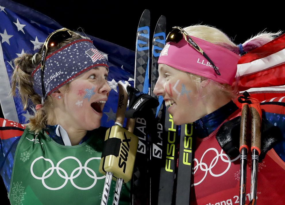 United States' Jessica Diggins, left, and Kikkan Randall celebrate after winning the gold medal at the 2018 Winter Olympics.  (AP Photo/Matthias Schrader)