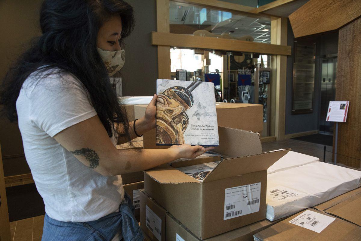 In this June 7, 2021, photo, Rebecca Hsieh unpacks copies of