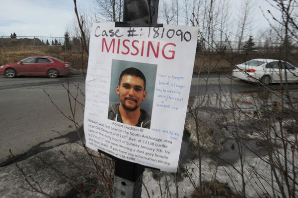 Missing person signs are posted around town for Robert Dushkin III who was last seen three months ago near E 120th Avenue and Division Street in South Anchorage. (Bill Roth / ADN)