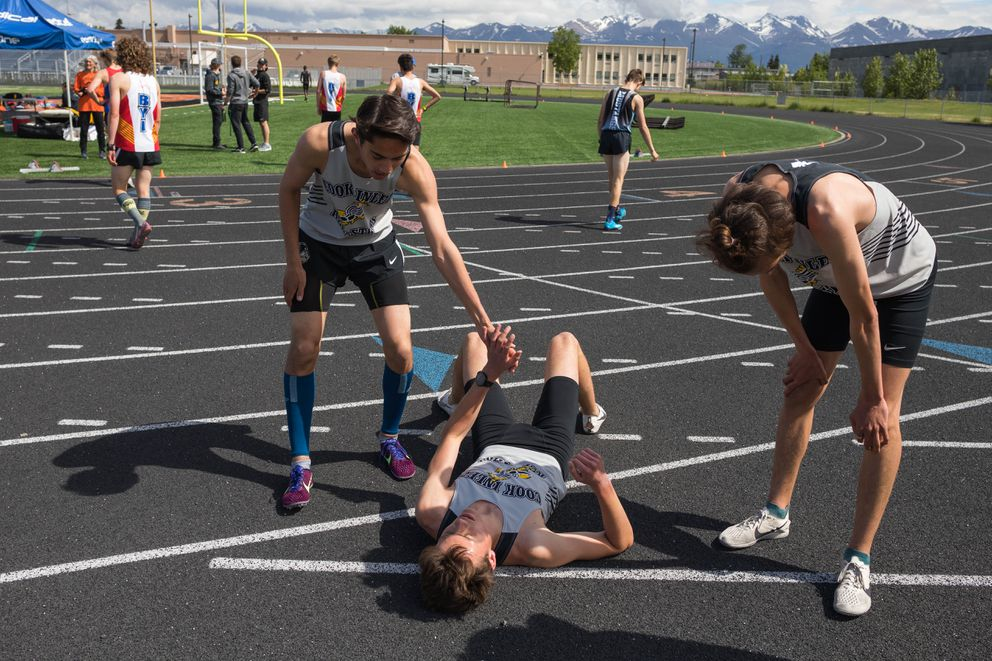 Chugiak's Hyrum Nelson recovers after winning the 1600 meter race at the Brian Young Invitational Friday, May 31, 2019 at West High. (Loren Holmes / ADN)