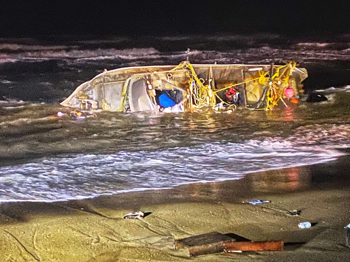 A 32-foot gold mining dredge overturned Thursday night, Oct. 15, 2020, near Nome. Two men remain missing while a third was able to make it to shore. (Photo courtesy Jim West Jr.)