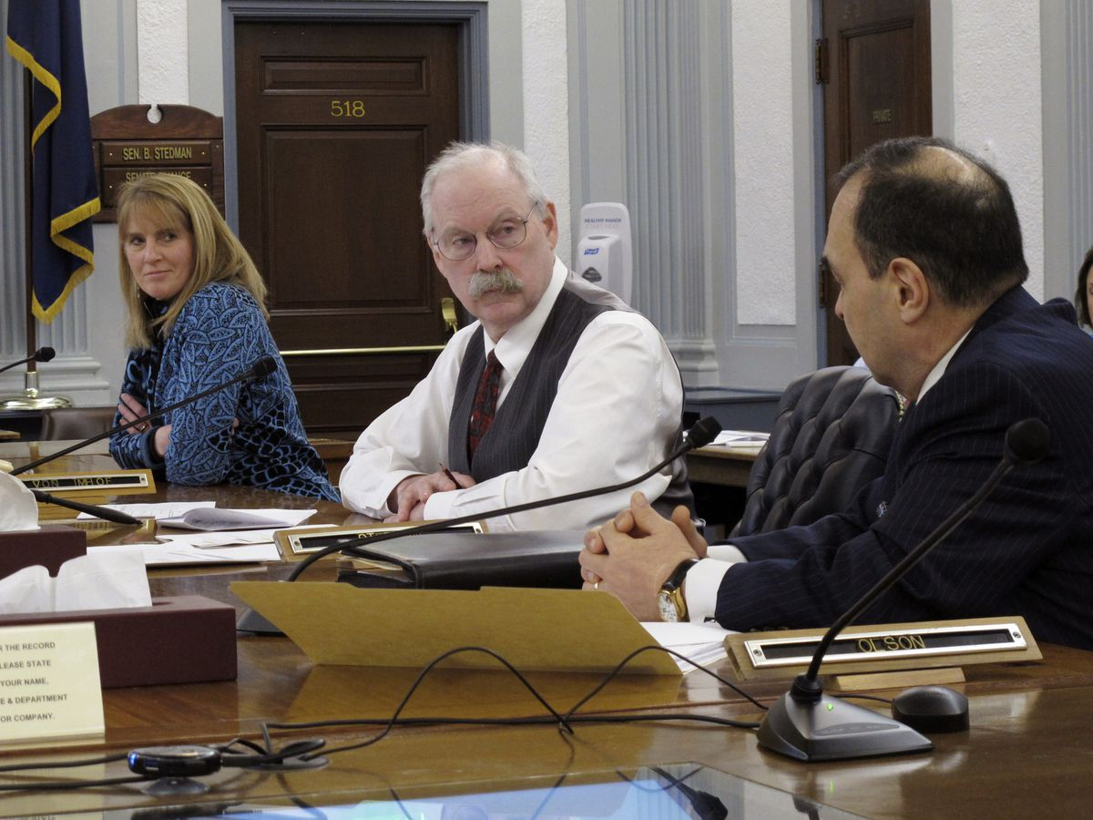 Alaska state Sen. Donny Olson, right, speaks as Senate Finance Committee Co-chairs Natasha von Imhof and Bert Stedman, center, listen during a conference committee meeting on Friday, March 27, 2020, in Juneau, Alaska. A conference committee of House and Senate negotiators was tasked with hammering out differences on a state spending package. (AP Photo/Becky Bohrer)