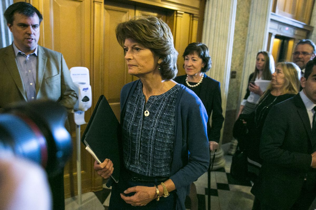Sens. Lisa Murkowski, R-Alaska, left, and Susan Collins, R-Maine, arrive at a Senate vote to confirm Betsy DeVos as education secretary, on Capitol Hill in Washington. (Al Drago / The New York Times)
