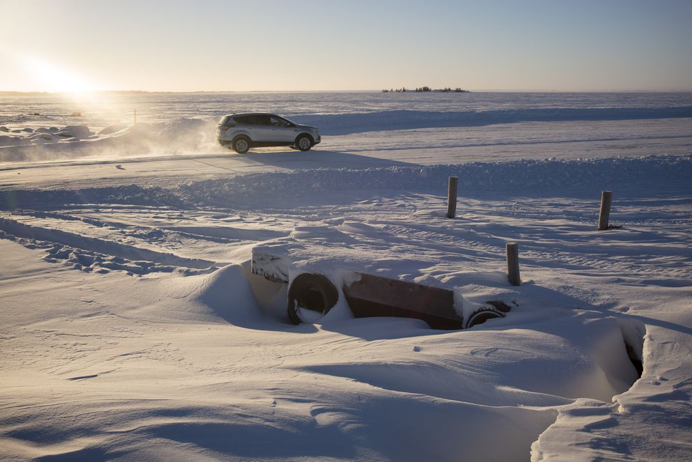 A vehicle drives along the Dettah ice road in Yellowknife, Northwest Territories, Canada, Jan. 22, 2017. (Ian Willms/The New York Times)