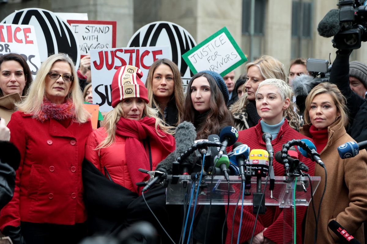 From left, Louise Godbold, Rosanna Arquette, Dominique Huett, Sarah Ann Masse, Paula Williams (partially obscured), Rose McGowan and Lauren Sivan speak during a press conference held by a group of women called Silence Breakers outside Manhattan Criminal Court after Harvey Weinstein's arrival on Monday, Jan. 6, 2020 in New York. (Luiz C. Ribeiro/New York Daily News/TNS)