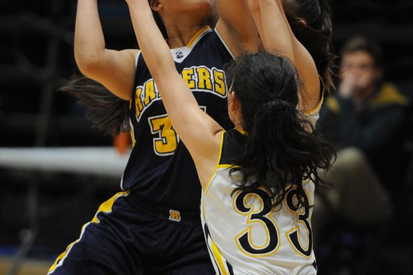 Mae Hiceta of Unalaska puts up a shot as Nenana senior Jasmine lake defends during Nenana's 46-33 victory during the Girls 2A quarterfinal game at the Alaska Airlines Center on Thursday, March 14, 2019. (Bill Roth / ADN)
