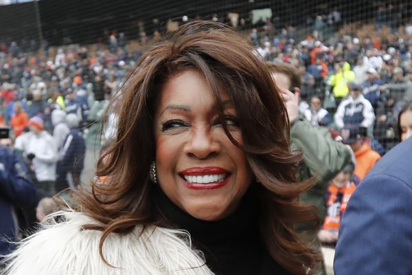 FILE - In this April 4, 2019, file photo, Mary Wilson, a former member of The Supremes, is escorted after singing the national anthem before a baseball game between the Detroit Tigers and the Kansas City Royals in Detroit. Wilson died in Las Vegas, publicist Jay Schwartz told KABC-TV. When she died and other details weren't immediately clear. She was 76. (AP Photo/Carlos Osorio, File)