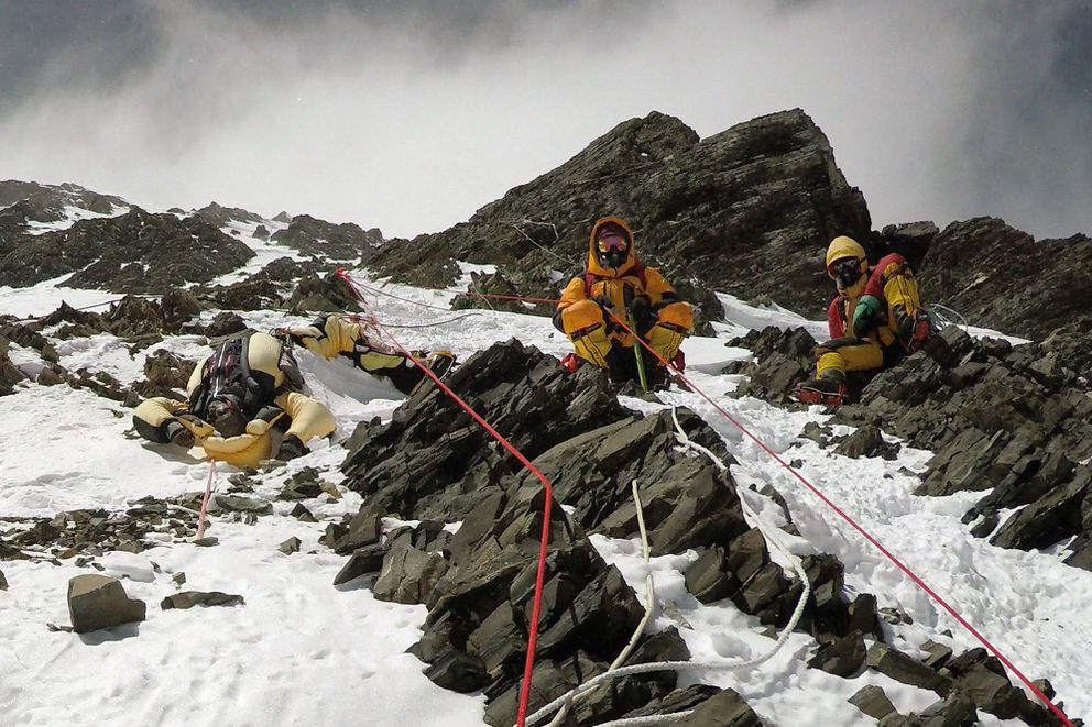 The body of Goutam Ghosh is brought down Mount Everest by two Sherpas in May 2017. (Dawa Finjhok Sherpa/Seven Summit Treks/The New York Times)