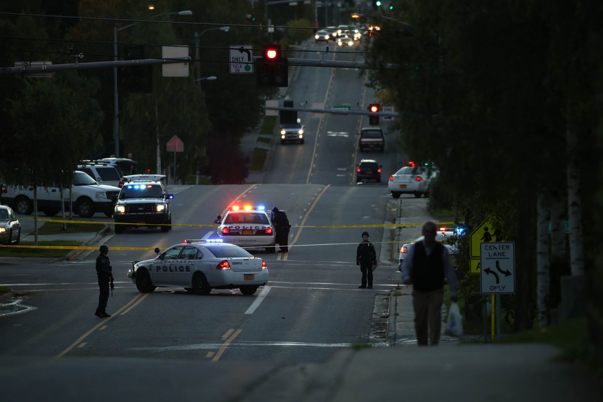 Anchorage Police Department personnel were investigating a fatal shooting near 15th Avenue and E Street early Sept. 13, 2016. APD asked morning commuters to avoid the area. (Loren Holmes / Alaska Dispatch News)