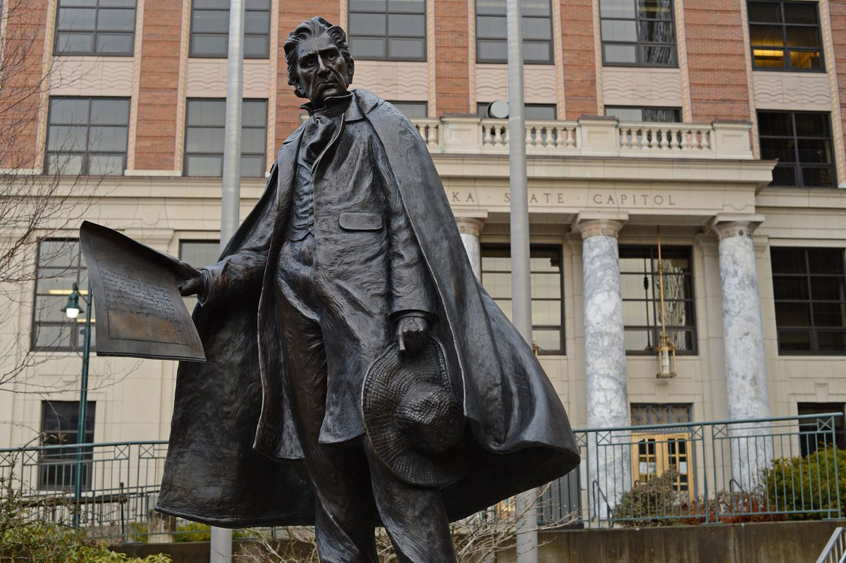 A statue of William Henry Seward stands in front of the Alaska State Capitol on Monday, Nov. 30, 2020. (James Brooks / ADN)