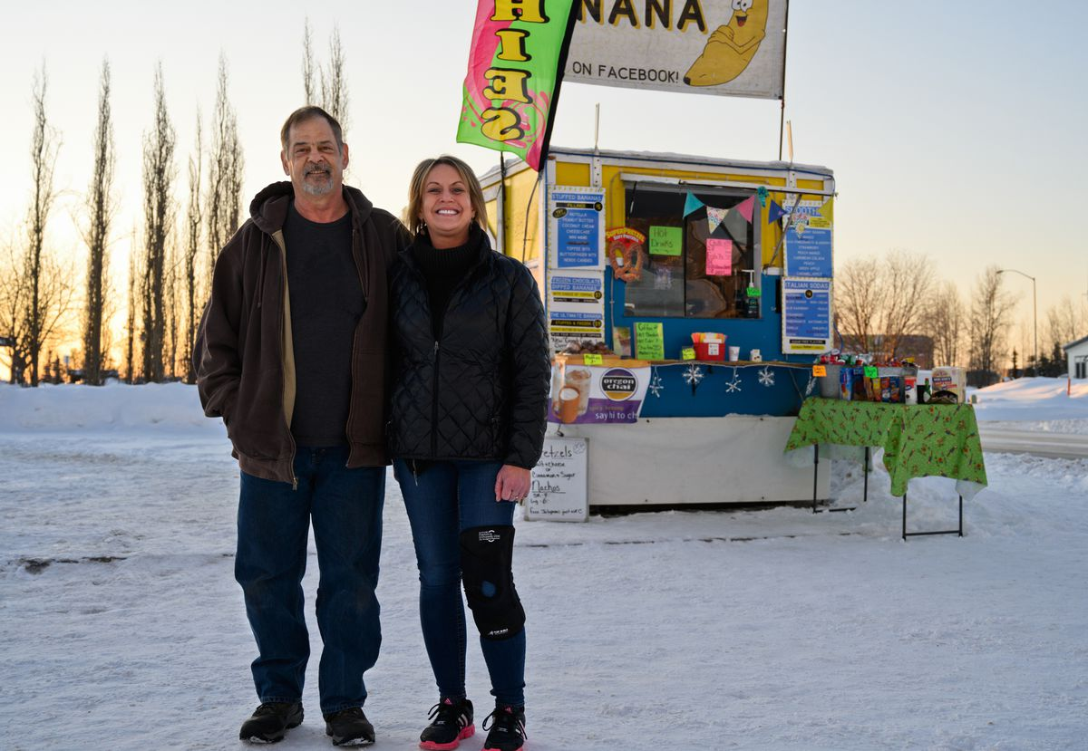 Husband and wife team James Wiegert and Karen House co-own AK Stuff Banana, a mobile food business, which is parked near the Fur Rendezvous Snow Sculpture Competition on March 4, 2020. (Marc Lester / ADN)