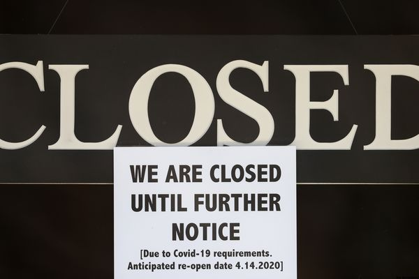 A notice of closure is posted at The Great Frame Up in Grosse Pointe Woods, Mich., Thursday, April 2, 2020. The coronavirus COVID-19 outbreak has triggered a stunning collapse in the U.S. workforce with millions of people losing their jobs in the past two weeks and economists warn unemployment could reach levels not seen since the Depression, as the economic damage from the crisis piles up around the world. (AP Photo/Paul Sancya)