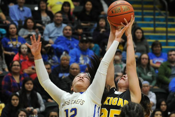 Alexis Russell, of Metlakatla, and Angela Lane, of Point Hope, go for the rebound in the championship game of the 2A girls Alaska State basketball tournament at the UAA Alaska Airlines Center in Anchorage, Alaska on Saturday, March 17, 2018. (Bob Hallinen / ADN)