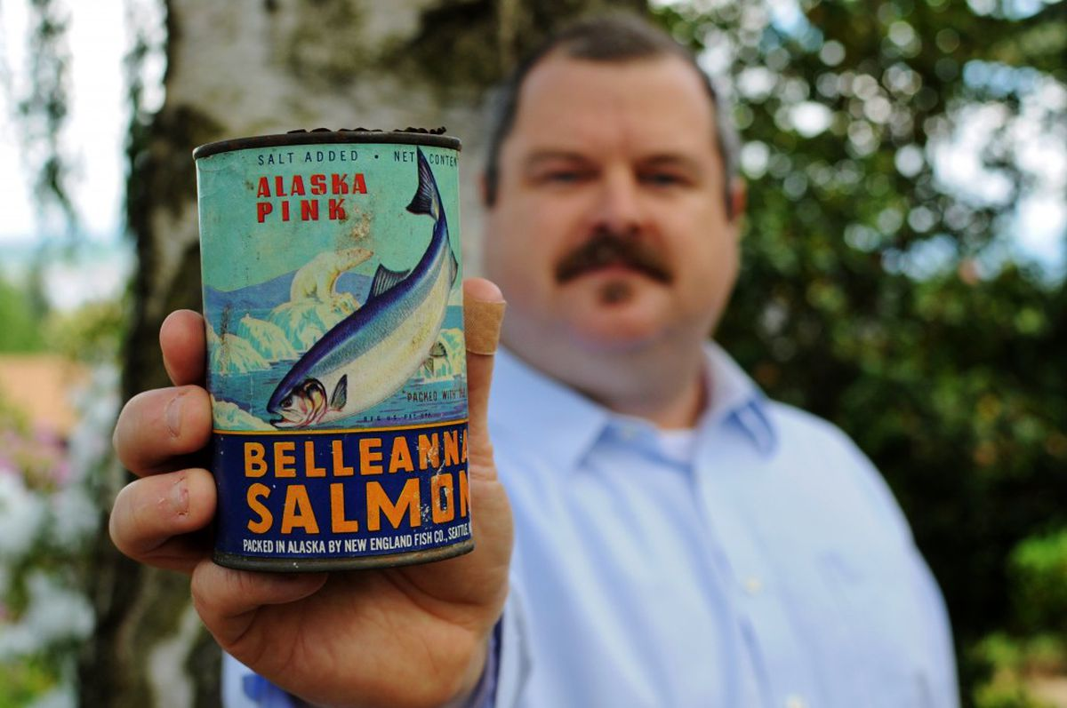 Ross Coen holds his antique salmon can. (Susan Dryer)