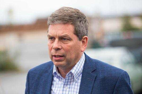 Mark Begich speaks to a reporter outside the Alaska Democratic Party coordinated campaign office Tuesday night, Aug. 21, 2018. (Loren Holmes / ADN)