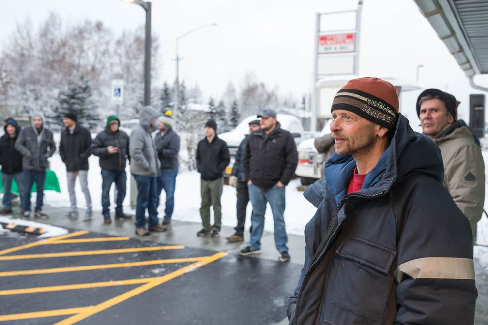 Michael Strand waits in line to buy marijuana at Arctic Herbery on Thursday, Dec. 15, 2016. Arctic Herbery was the first legal marijuana retail store to open in Anchorage, Alaska's largest city. (Loren Holmes / Alaska Dispatch News)