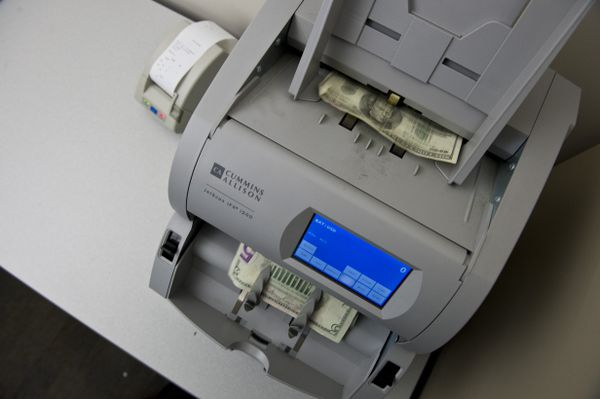 A cash-counting machine run by the Alaska Department of Revenue has processed more than $4 million in cannabis taxes, according to Kelly Mazzei, excise tax supervisor. Photographed Jan. 17. (Marc Lester / ADN)
