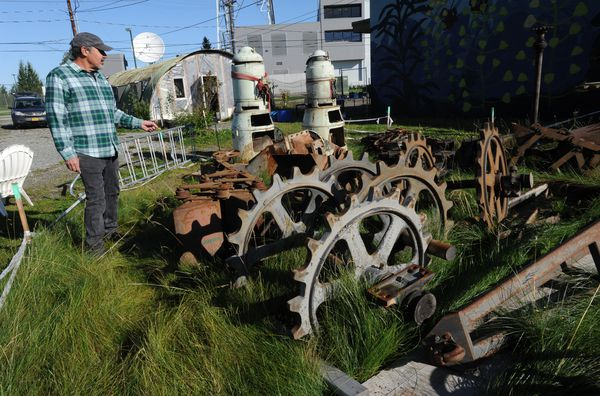 Steve Gerlek talks about items from the old Chugach power plant at Ship Creek that were donated to the Government Hill Commons and community orchard. (Bill Roth / ADN)
