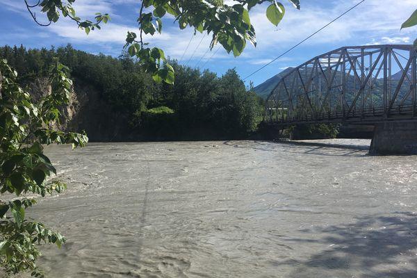 The Matanuska River is flowing high at the old bridge over the river, June 20, 2018. (Zaz Hollander / ADN)