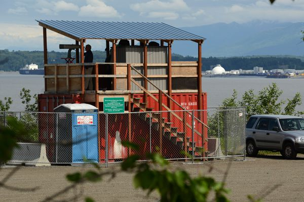 Observers keep eyes on the Knik Arm, looking for marine mammals during Port of Alaska dock construction, June 22, 2021. (Anne Raup / ADN)