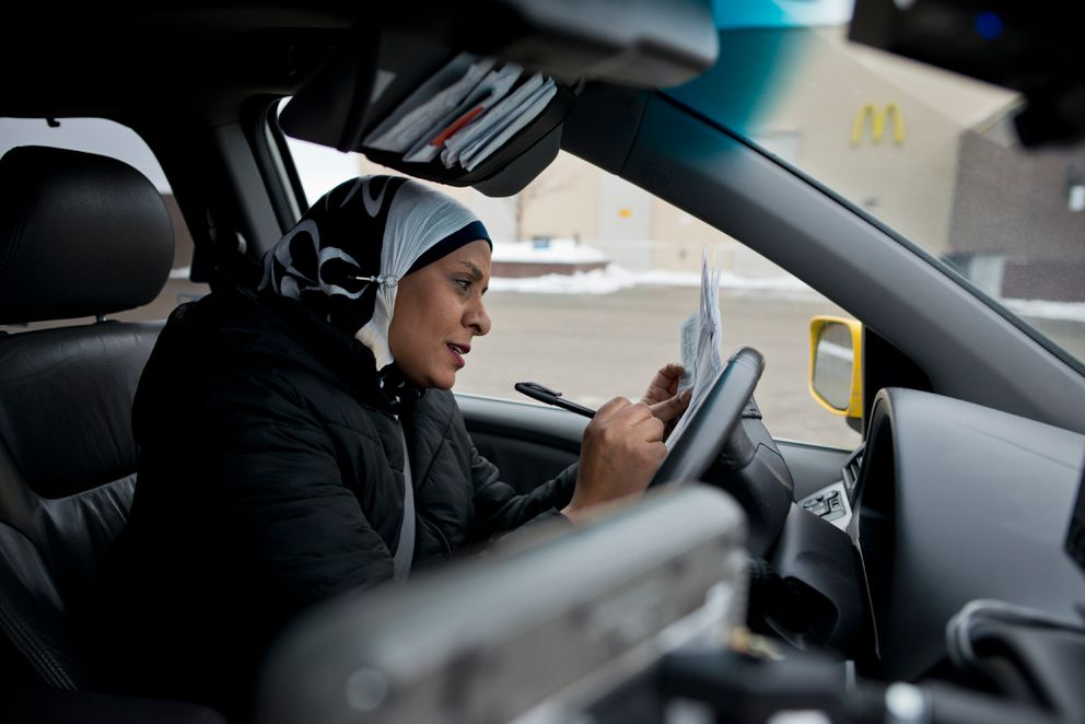 Zabeeba Mohamed records information during a shift driving a cab in Anchorage on Jan. 31, 2017.  (Marc Lester / Alaska Dispatch News)