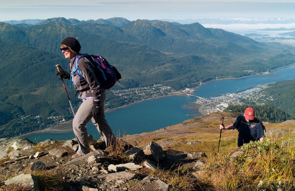 Shirley Carlson, left, and Julie Coghill take advantage of sunny weather to hike up to Gold Ridge in Juneau. (AP Photo/The Juneau Empire, Michael Penn)