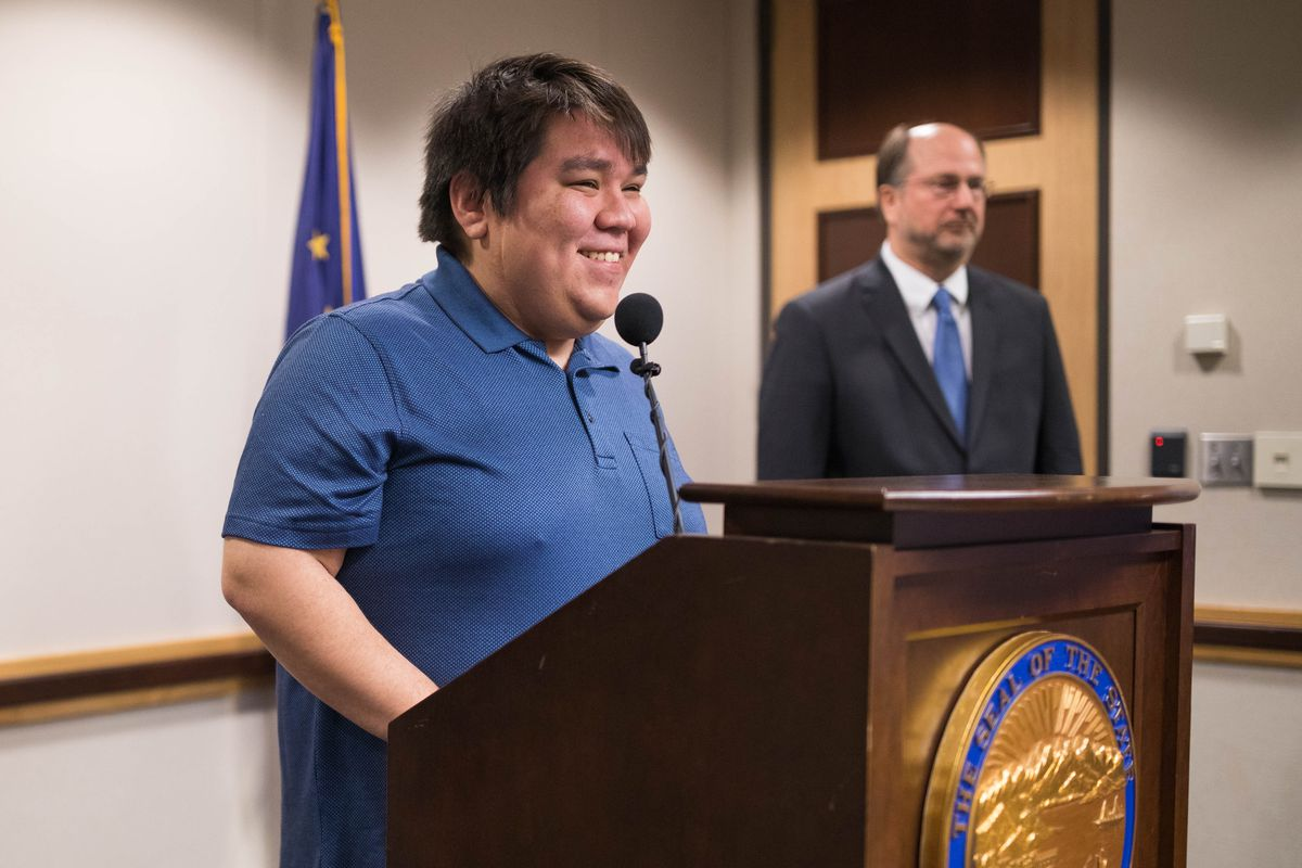 Stephen Hansell addresses the media after Gov. Mike Dunleavy announced that a legal judgement against Hansell has been satisfied, on Friday at the Atwood Building in Anchorage. At right is Attorney General Kevin Clarkson. (Loren Holmes / ADN)