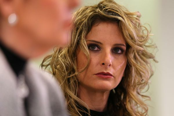 Summer Zervos listens as her attorney Gloria Allred speaks during a news conference announcing the filing of a lawsuit against President-elect Donald Trump in Los Angeles, California, U.S., January 17, 2017. REUTERS/Mike Blake