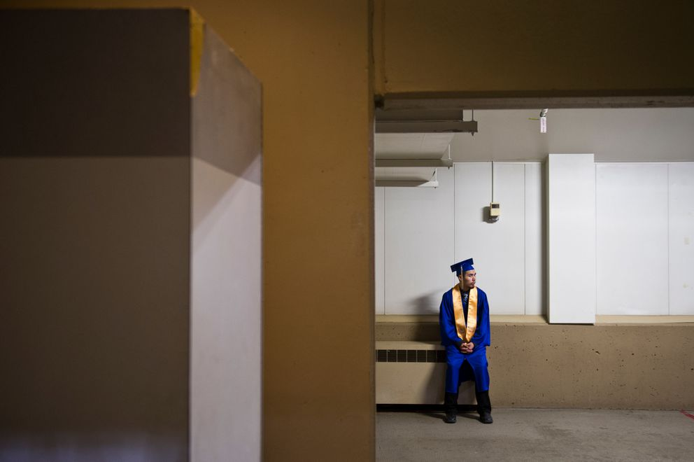 Bartlett High student Ryan Baker takes moment before his graduation ceremony at the Sullivan Arena in 2015. (Marc Lester / ADN archive)