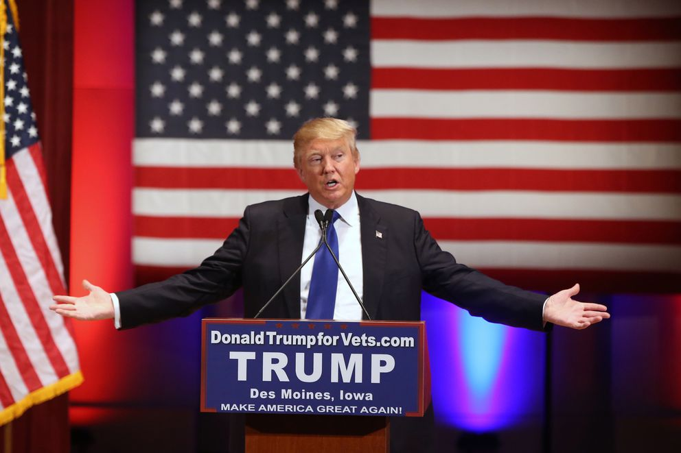 FILE - In this Jan. 28, 2016 file photo, Donald Trump speaks behind a DonaldTrumpforVets.com sign at a fundraising event in Des Moines, Iowa, at Drake University during Trump's campaign for president. New York Attorney General Barbara Underwood filed a lawsuit Wednesday June 13, 2018, accusing Trump of illegally using his charitable foundation to pay legal settlements related to his golf clubs and to bolster his presidential campaign. The complaint said the Iowa event, held in lieu of Trump participating in a televised debate the same day, which billed itself as allowing donors to make charitable contributions to veterans' organizations was, in reality, a Trump campaign event in which the Trump Foundation shouldn't have participated. (AP Photo/Andrew Harnik, File)