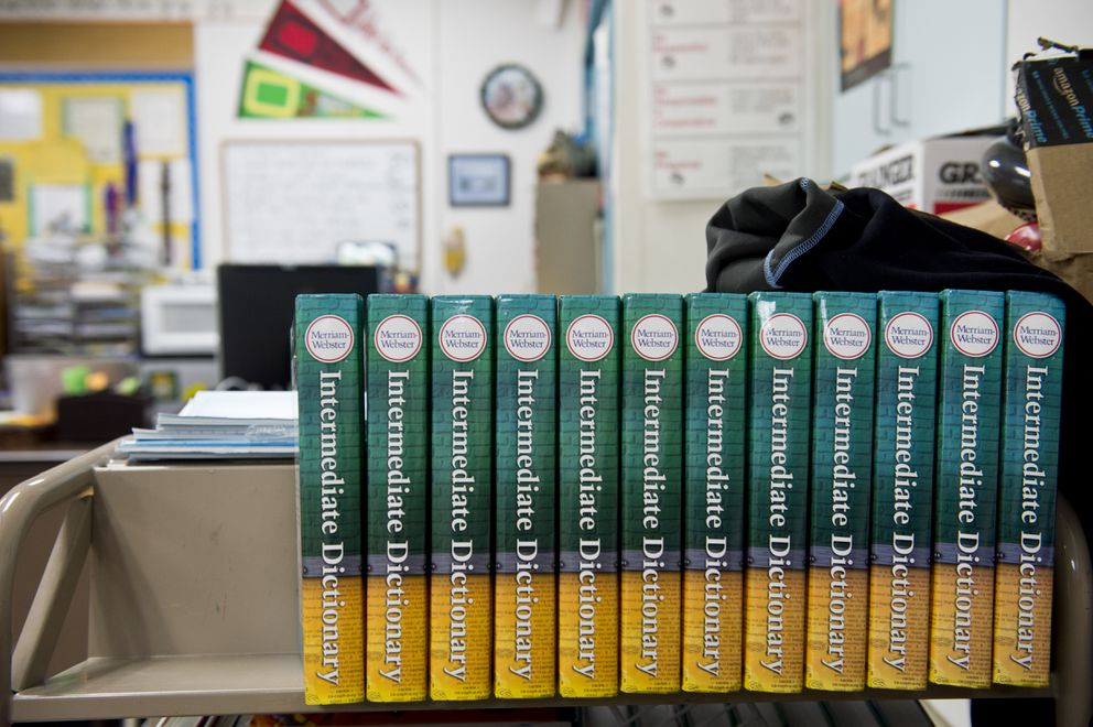 College Gate Elementary School sixth-grade teacher Gerald Tennyson has used the DonorsChoose.org website to crowdfund items for his class, including these dictionaries. (Marc Lester / ADN)