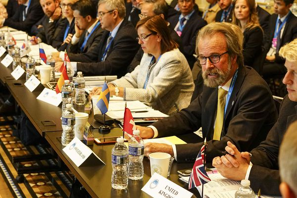 Konrad Steffen, wearing glasses and a yellow tie, at the White House in 2016, where he represented Switzerland at the first Arctic Ministerial Conference. (Photo courtesy Swiss Federal Institute for Forest, Snow and Landscape)