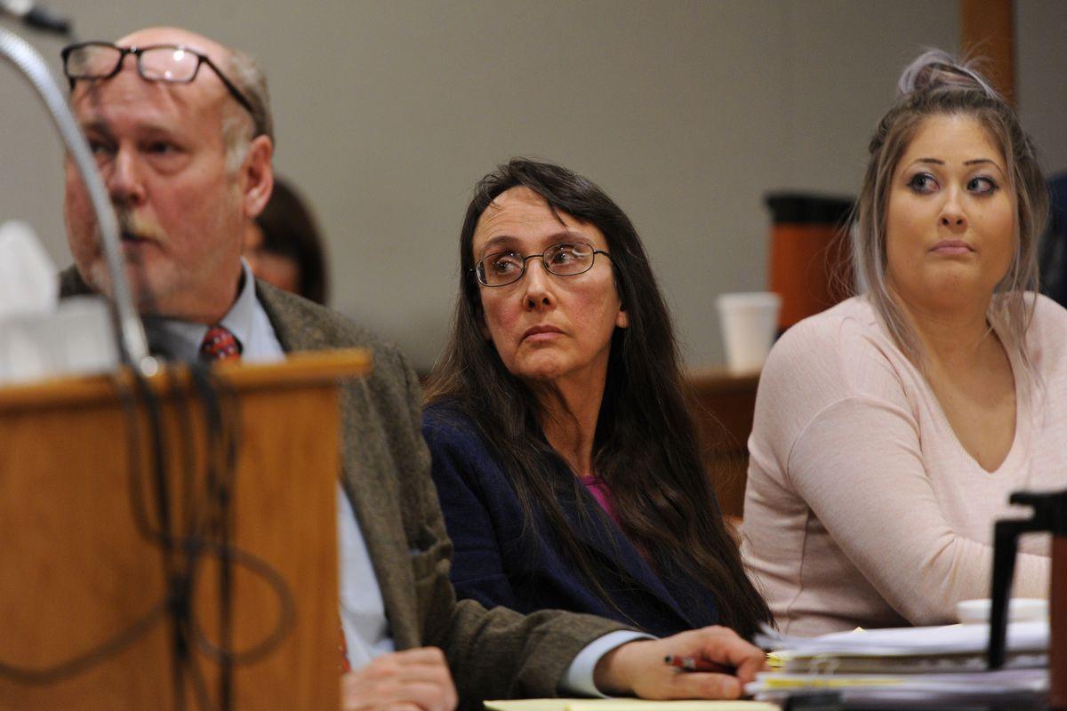Adoptive mother Anya James, center, listens to testimony during her sentencing at the Nesbett Courthouse on Tuesday. (Bill Roth / Alaska Dispatch News)