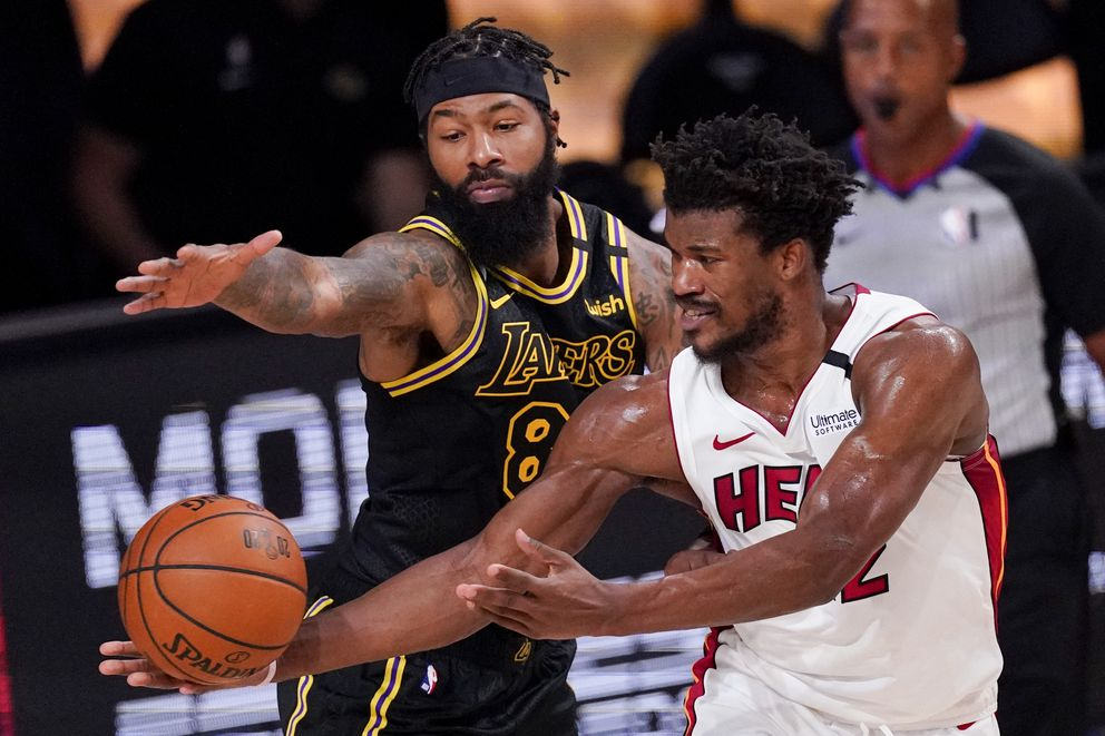 Los Angeles Lakers forward Markieff Morris vies for a rebound with Miami Heat forward Jimmy Butler during the second half in Game 5 of basketball's NBA Finals Friday, Oct. 9, 2020, in Lake Buena Vista, Fla. (AP Photo/Mark J. Terrill)
