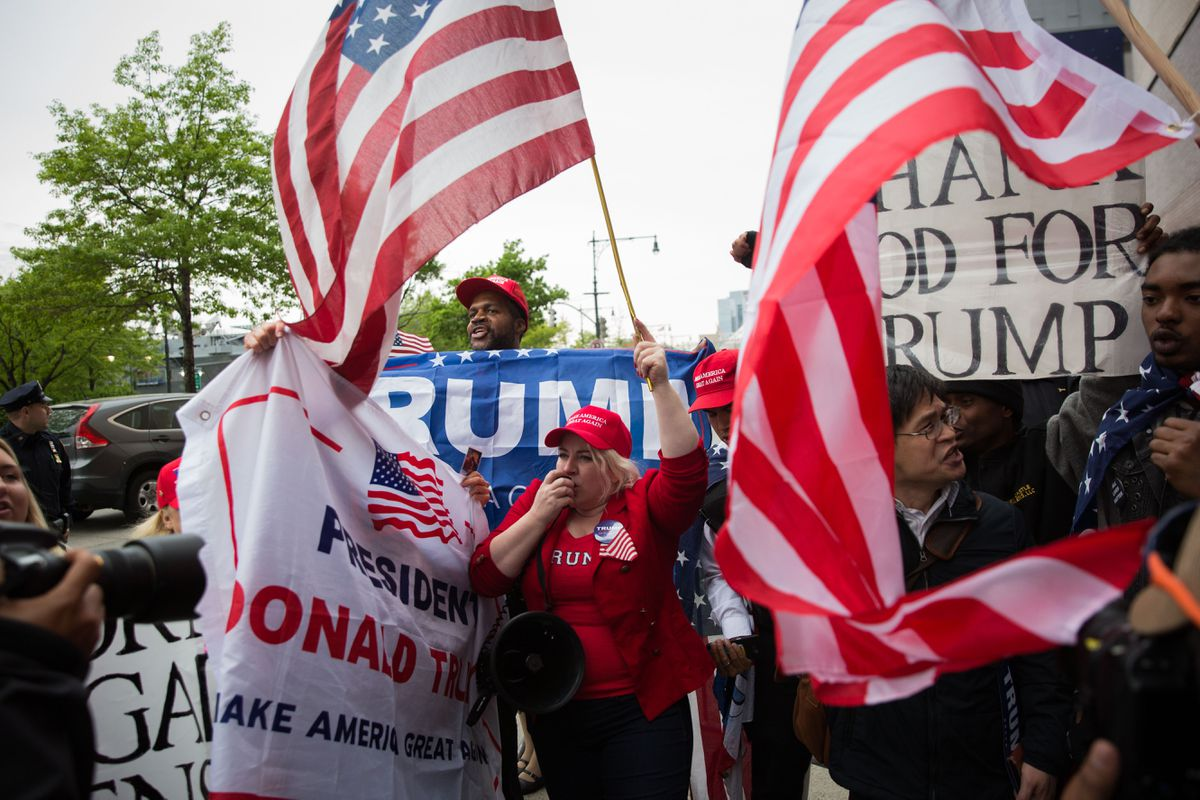 Supporters of President Donald Trump supporters rally outside his visit to the Intrepid Sea, Air & Space Museum in Manhattan, May 4, 2017. (Kevin Hagen/The New York Times file)