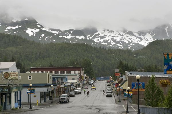 Snow sprinkles the Chugach mountain range overlooking the main street in Cordova, Alaska. Moved Wednesday, Sept. 2, 2015. (MUST CREDIT: Washington Post photo by Nikki Kahn.)