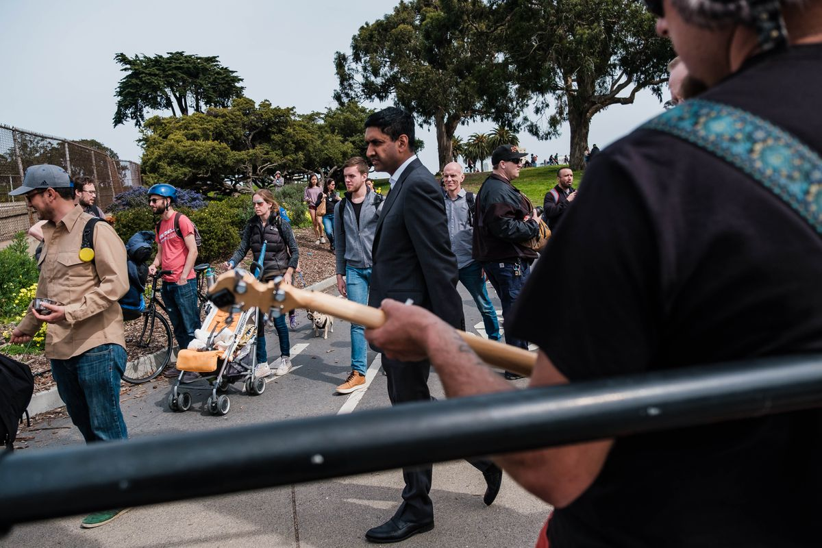 Rep. Ro Khanna, D-Calif., walks toward his car after a Bernie Sanders rally in San Francisco. (Photo by Nick Otto for The Washington Post)