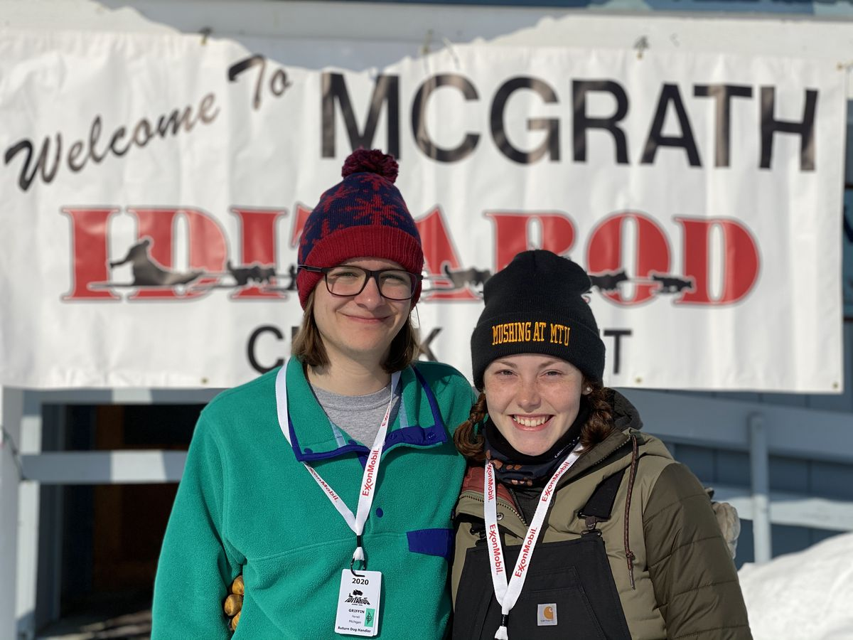 Griffing Ferrell, 20, from left, and Katy Gehrke, 19, photographed on Wednesday at the Iditarod checkpoint of McGrath. Ferrell and Gehrke are members of the mushing club at Michigan Tech University in Houghton, Michigan. (Photo by Blair Braverman)