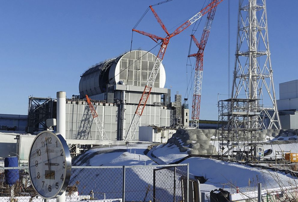 FILE - In this Jan. 25, 2018, file photo, an installation of a dome-shaped rooftop cover housing key equipment is near completion at Unit 3 reactor of the Fukushima Dai-ich nuclear power plant ahead of a fuel removal from its storage pool in Okuma, Fukushima Prefecture, northeast Japan. Tokyo Electric Power Co. said Monday, April 18, 2019, workers started removing the first of 566 fuel units stored in the pool at Unit 3. The fuel units in the pool are not enclosed and their removal to safer ground is crucial to avoid disaster in case of another major quake. (AP Photo/Mari Yamaguchi, File)