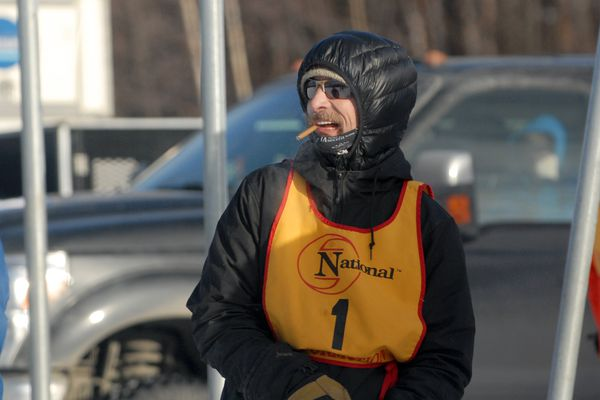 Lance Mackey shouts instructions to a handler before the start of the first day of the Eagle River Classic sprint dog races on Saturday, Feb. 2, 2019 at the Chugiak Dog Mushers Association Beach Lake Trails. (Star photo by Matt Tunseth)